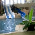 Indoor pool area with fun flumes